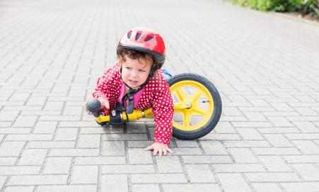 child falling off bike